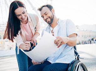 smiling handsome boyfriend in wheelchair