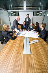 Team members and colleagues collaborating around a conference table