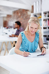 Woman working on paperwork at table