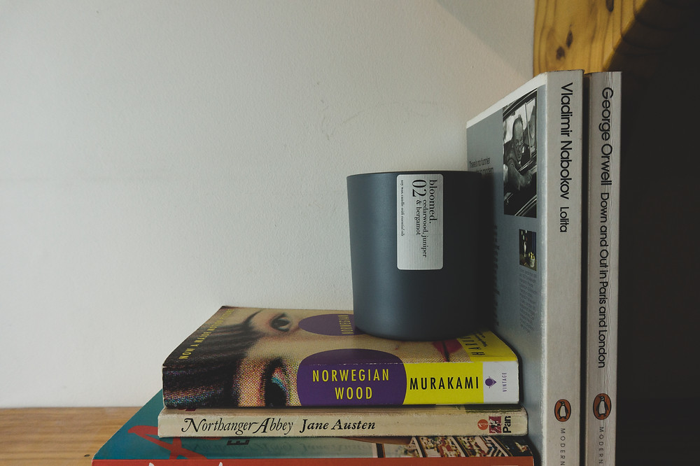 a candle sit on a pile of books
