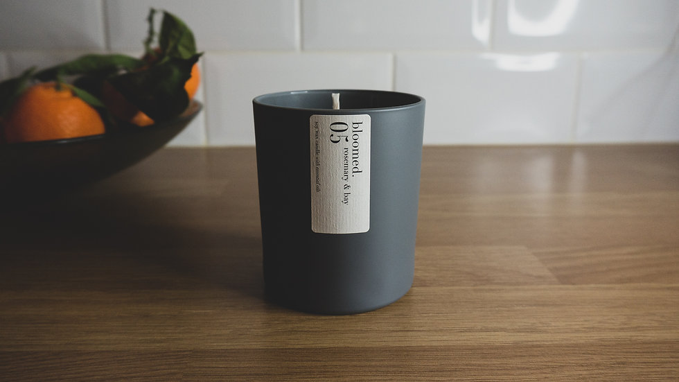 grey-soy-wax-candle-with-bowl-of-oranges