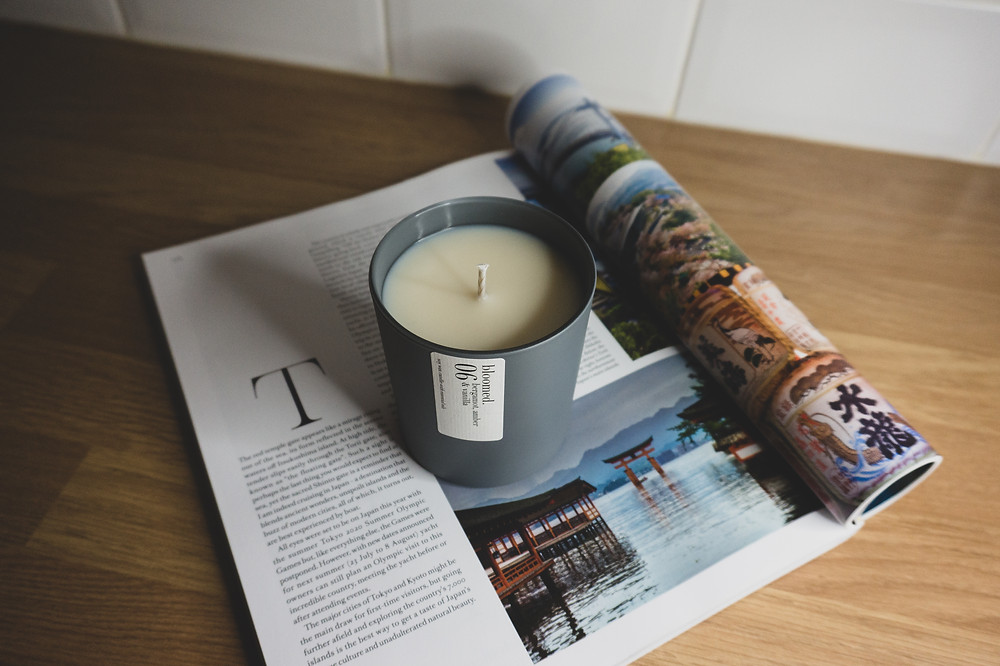 candle on a travel magazine