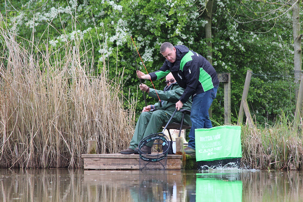 Match Aid's Paul Roberts helps Stan land a decent carp