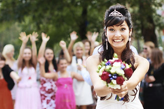 Bride Throwing Bouquet For Guests To Catch.jpg