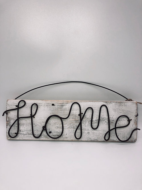 Home sign on white - wash board