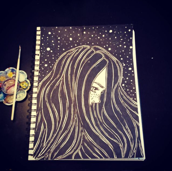 Girl looking down, with a starry sky background