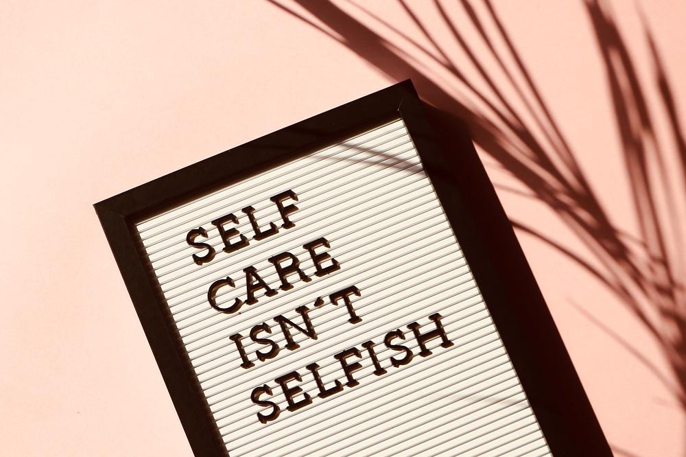 "Sign says ""Self care isn't selfish"""