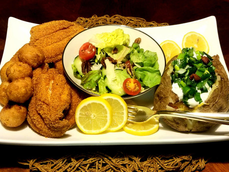 Fried Catfish, Sweet Corn Hush Puppies accompanied with a Loaded Baker and side Salad