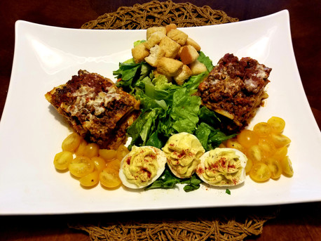 Scratch made Beef and Four Cheese Lasagna, Deviled Eggs and Salad with Croutons and Golden Sweet Mini Matoes.