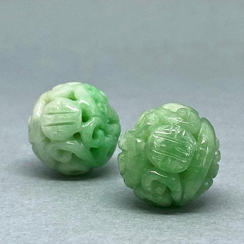 Jadeite bead ~  A translucent green jadeite bead carved dragon and longe