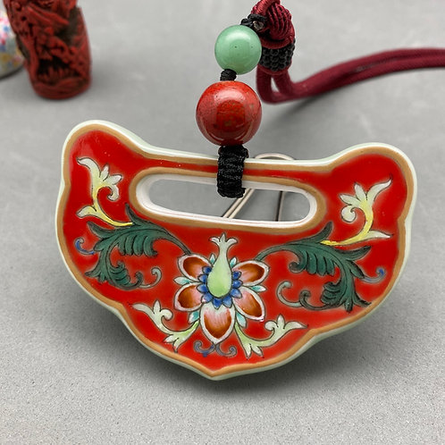 Hand painted porcelain pendant necklace: Bright red ground famille rose