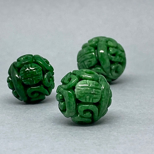 Jadeite bead ~  A translucent green jadeite bead carved dragon and longevity