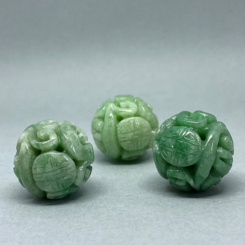 Jadeite bead ~  A translucent green jadeite bead carved dragon and longe