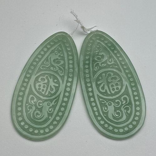Jadeite pendant ~ A pair of very translucent apple green jadeite teardrop