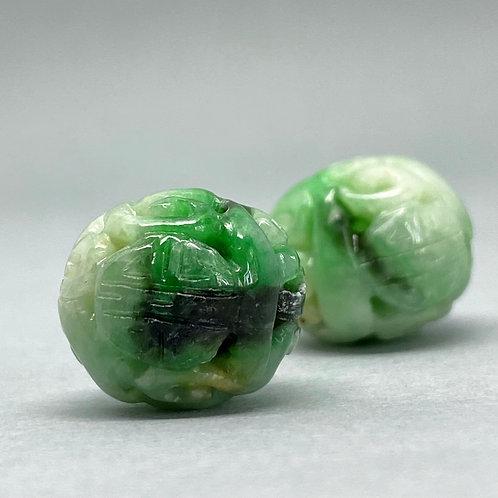 Jadeite bead ~  Pumpkin shape A translucent green jadeite bead carved dragon