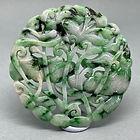 Jadeite pendant of two koi fish
