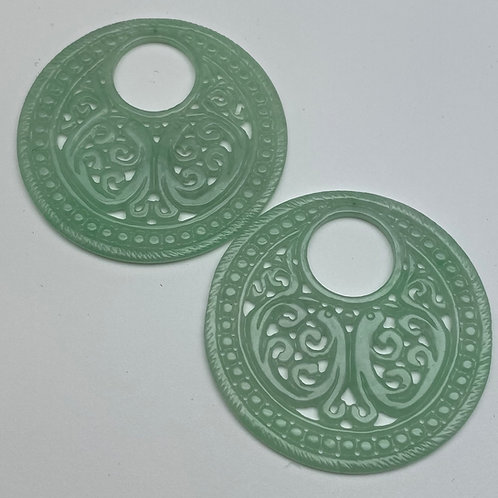Jadeite pendant ~ a pair of translucent green jade intricate carved donut