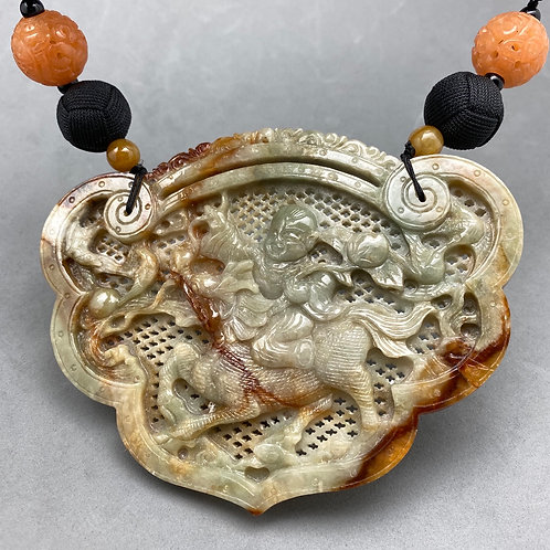 Jadeite necklace ~ Brown jadeite pendant carved with a boy riding
