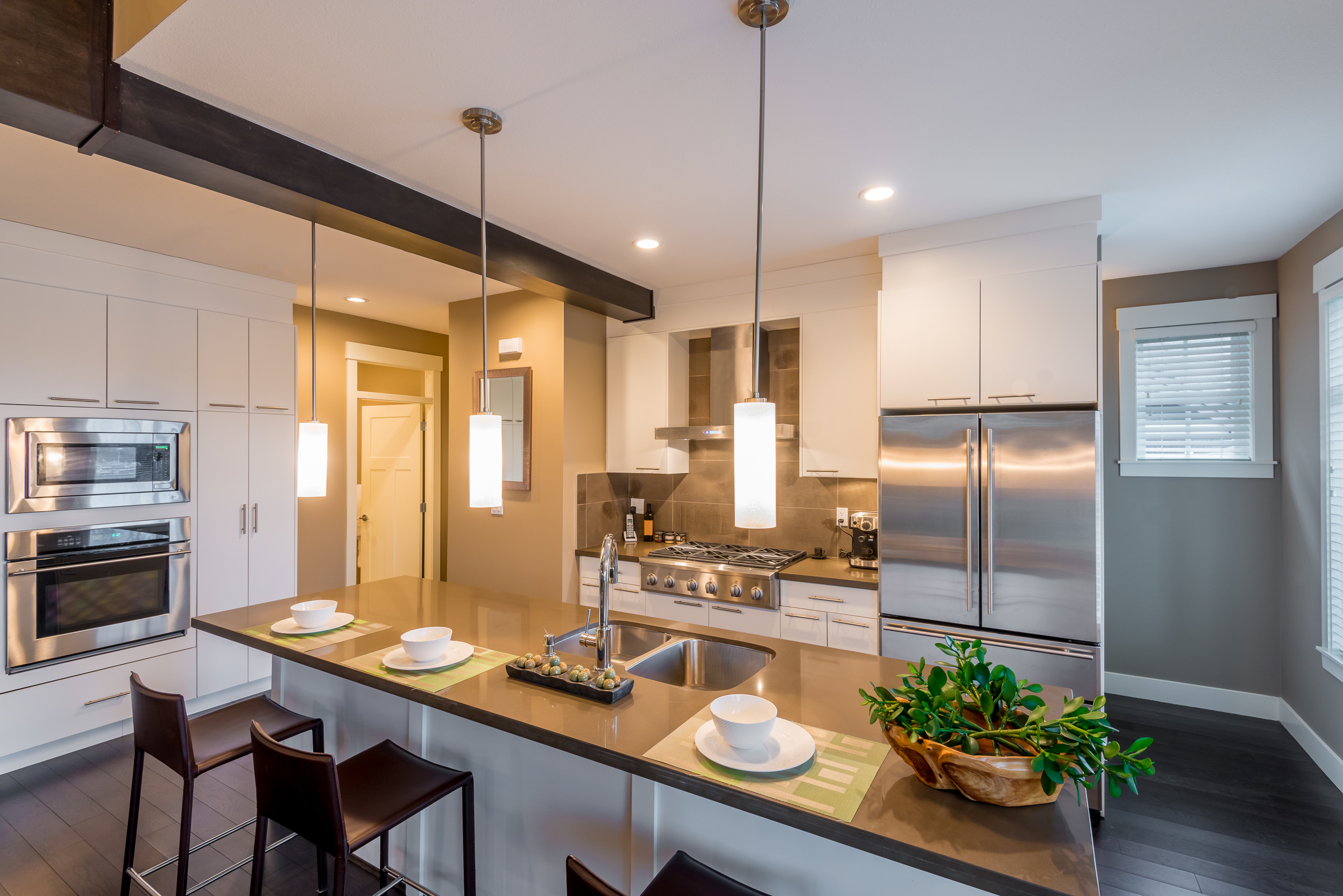 Modern, bright, clean, kitchen interior with stainless steel appliances in a luxury house