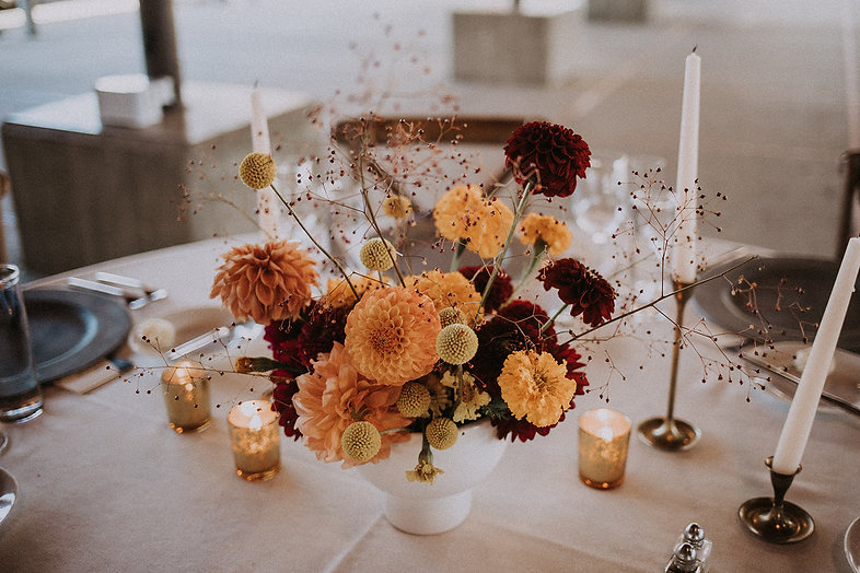 Bright floral arrangement wedding centerpiece