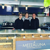 The Mezzaluna team at a market
