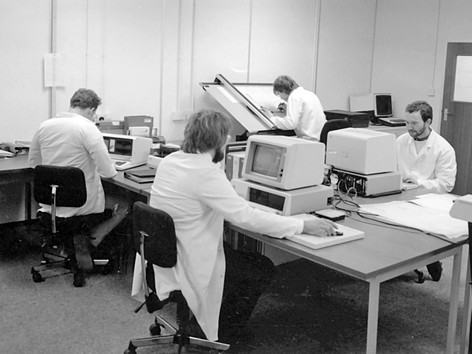 Ian Handricks (in foreground) with first IBM PC (1981) - David ranson sitting opposit with Roy Dorey at drawing board