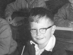Ian sitting at desk Glen Innes Primary School