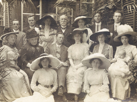 Ruby Staggard holding baby Gwendoline Handricks (far right middle row) with the Corrick family