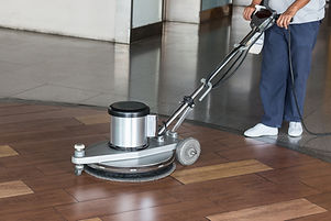 Woman Cleaning The Floor With Polishing Machine.jpg
