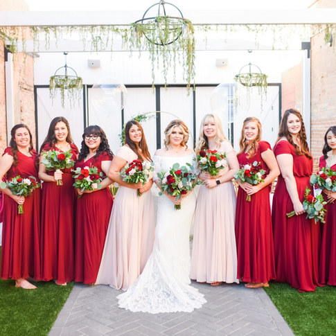 bridal party wearing red dresses young bride