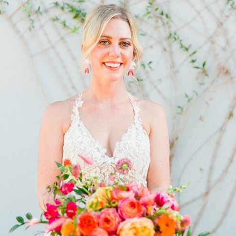 Summer bride holding colorful flowers