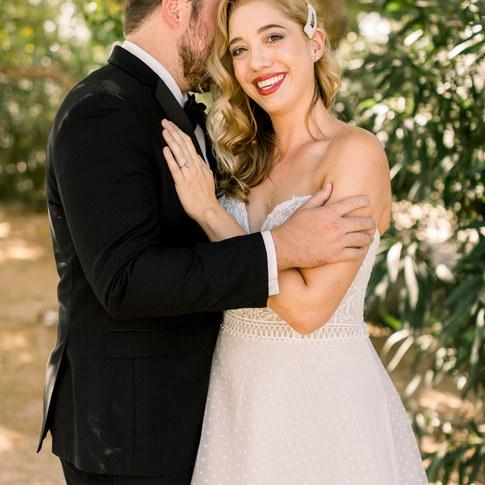 happy bride wearing a beautiful dress natural glowing makeup