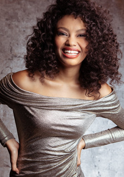 smiling woman curly hair