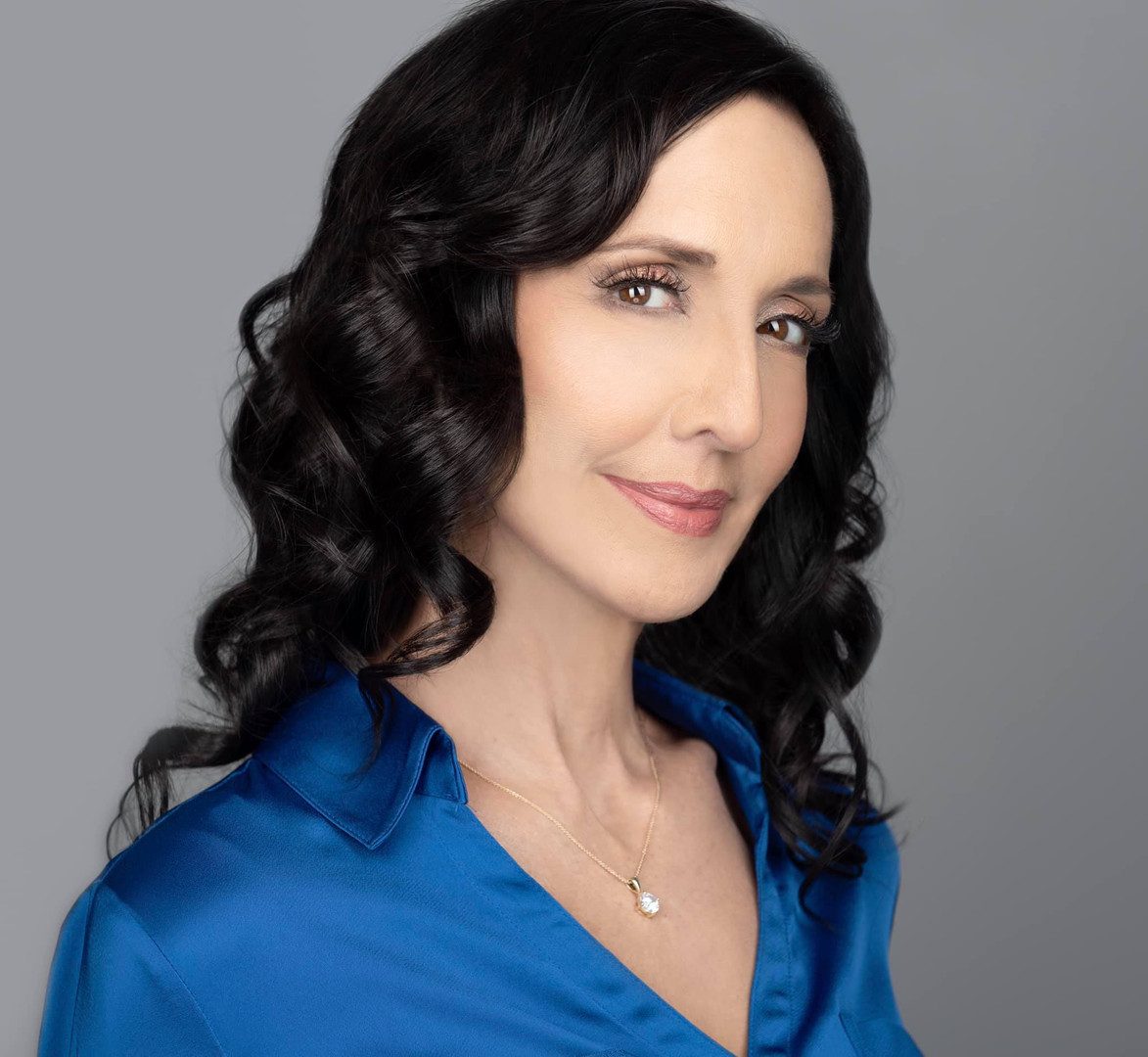 blue shirt mature woman