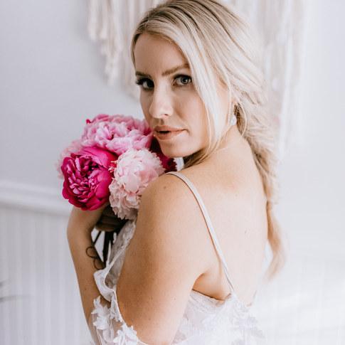 bride holding pink peonies
