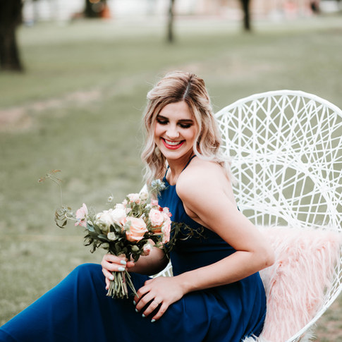 flowing hair and glowing makeup flowers blue dress