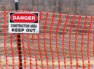 Danger Keep out sign hanging on orange c