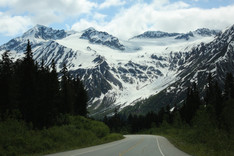 Driving down the pass toward Haines, Alaska. Intl. boarder crossing ahead, Haines Junction and some gorgeous country (edge of Kluane) behind.