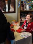 Susan Orlean signing books.