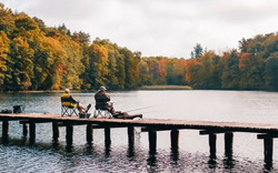 two-men-fishing-on-lake-1630039
