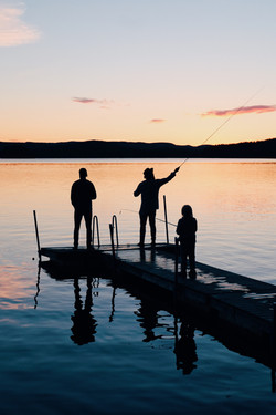 three-people-on-a-wooden-fishing-docks-9