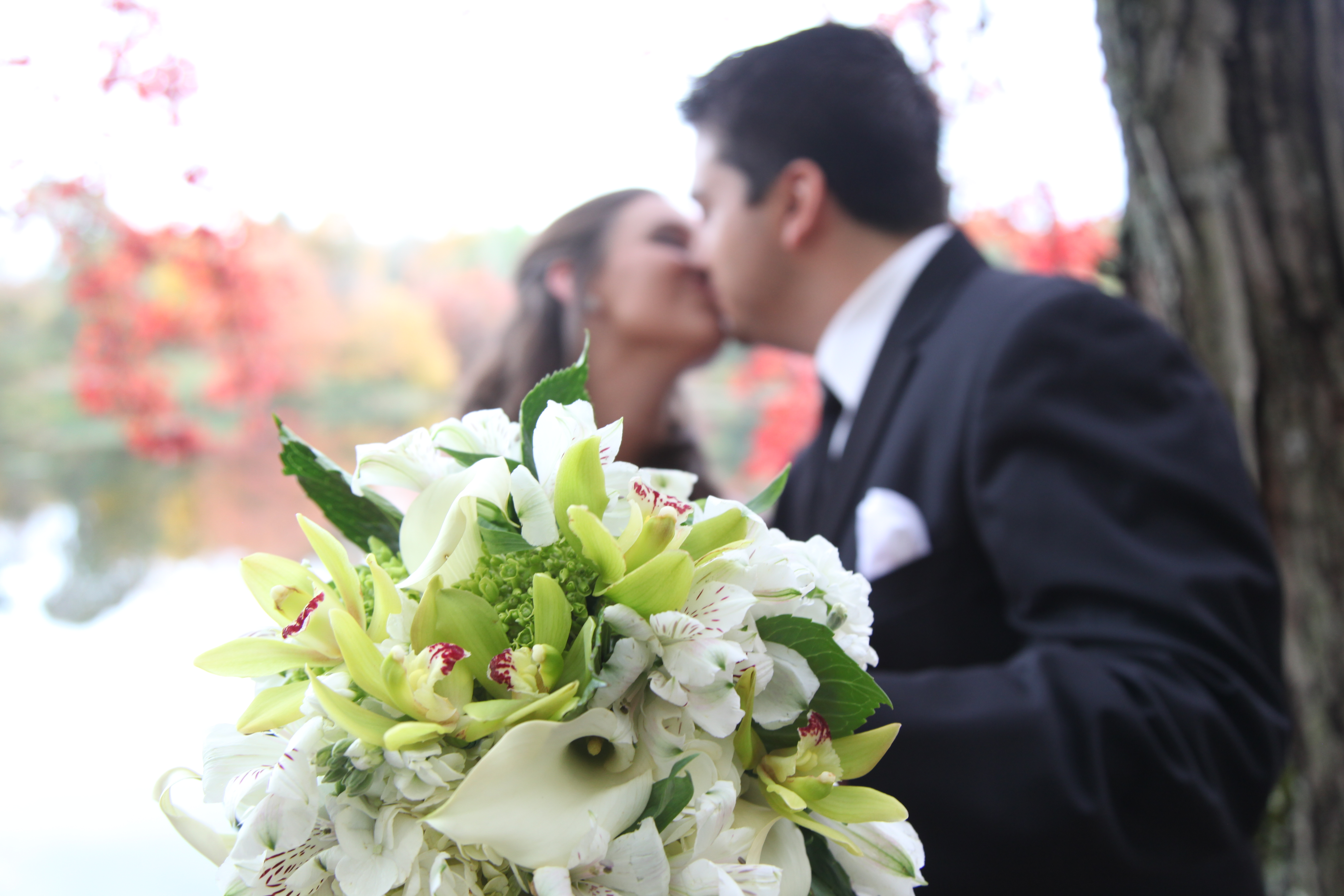 Bride and Groom Kiss with bouquet