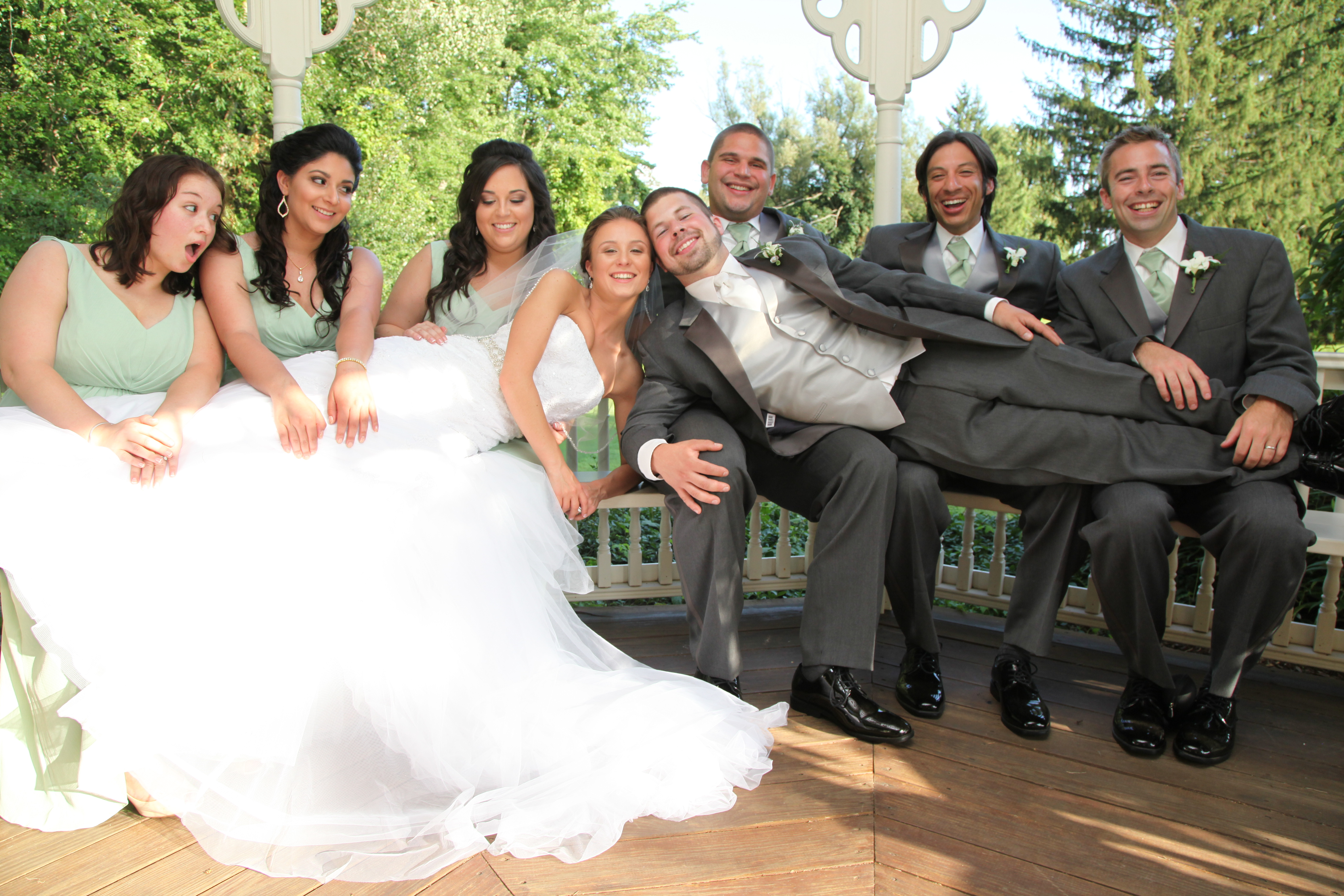 Bride and Groom lay on Bridal Party