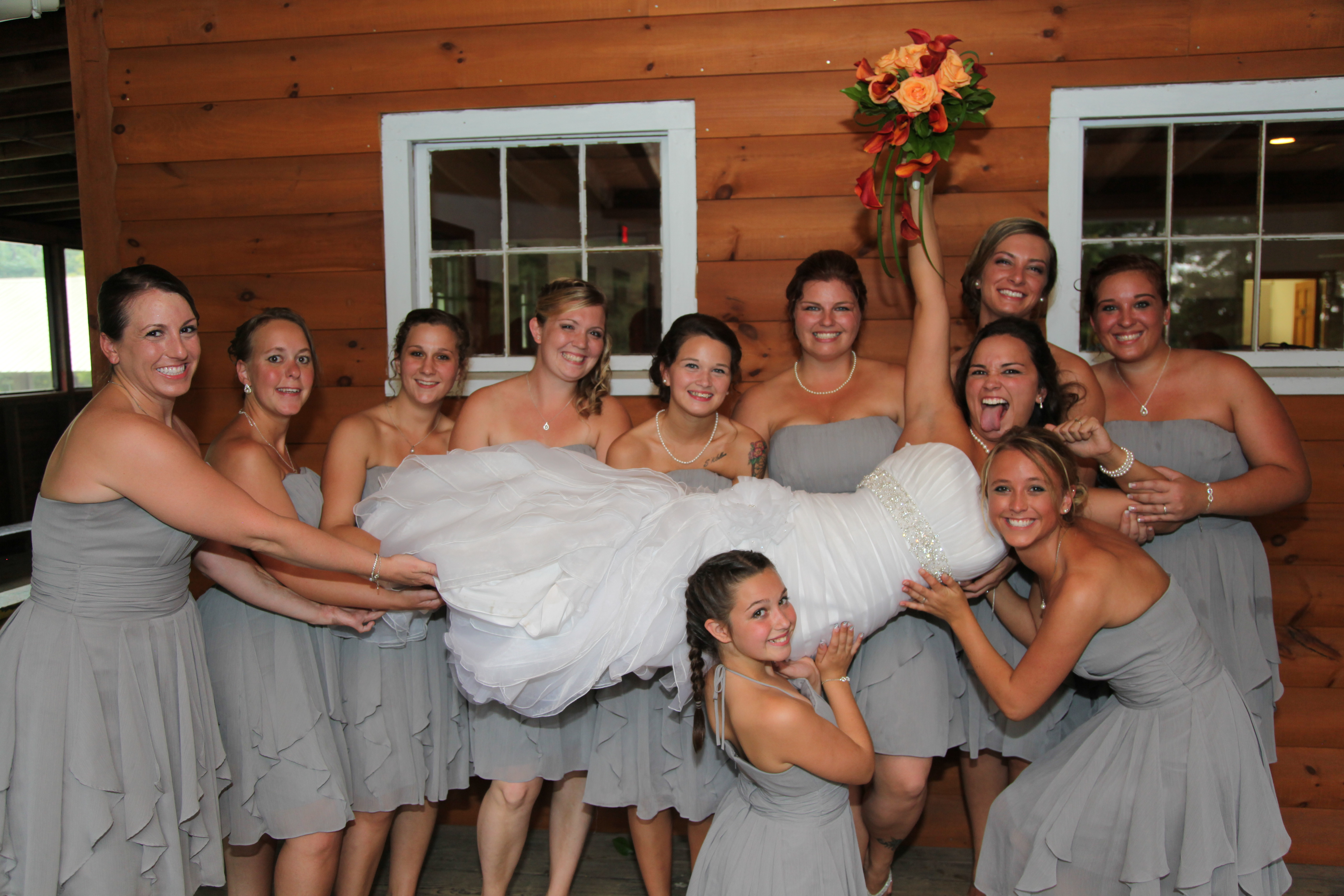 Bridal Party holds up the Bride
