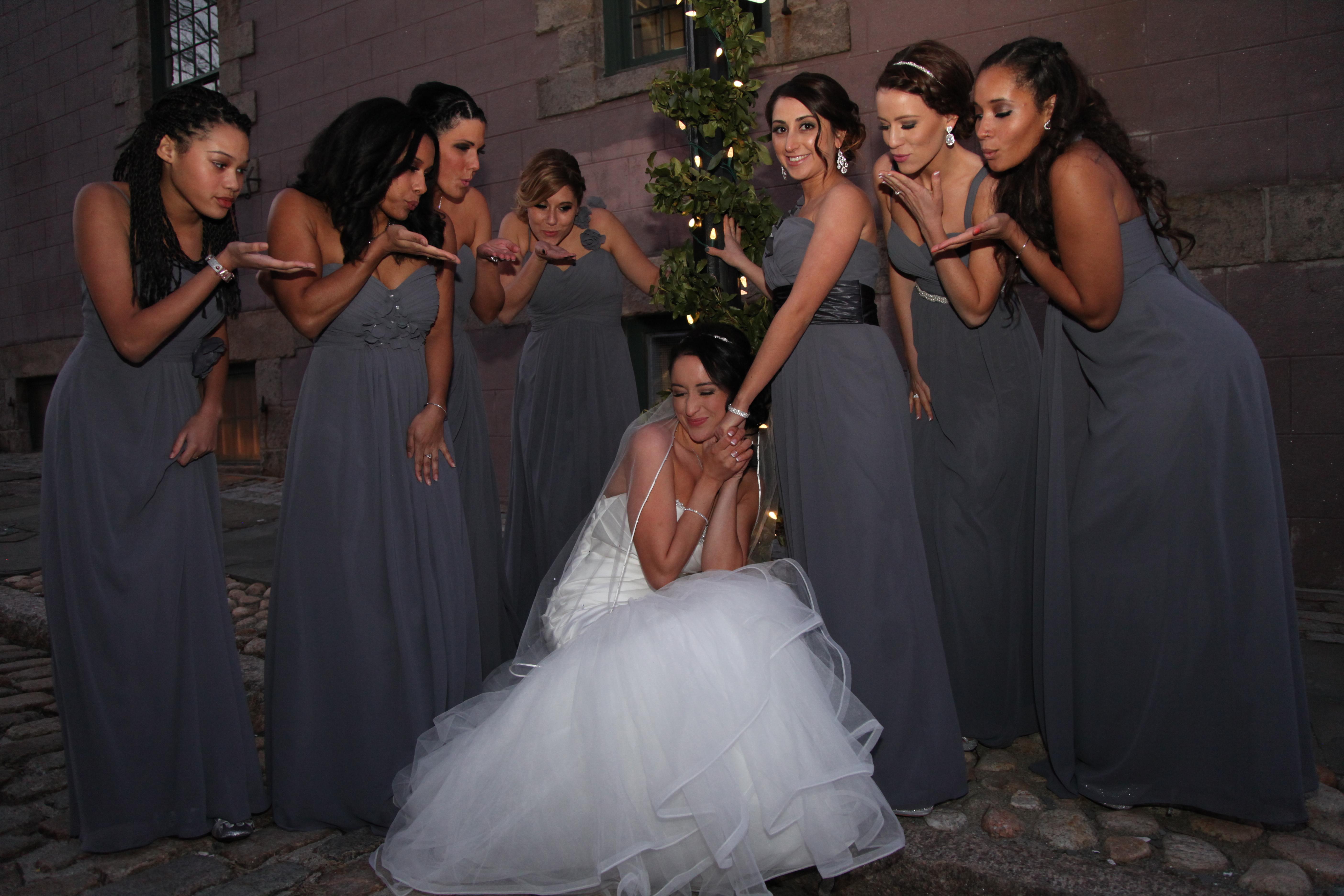 Bridesmaids kiss to Bride