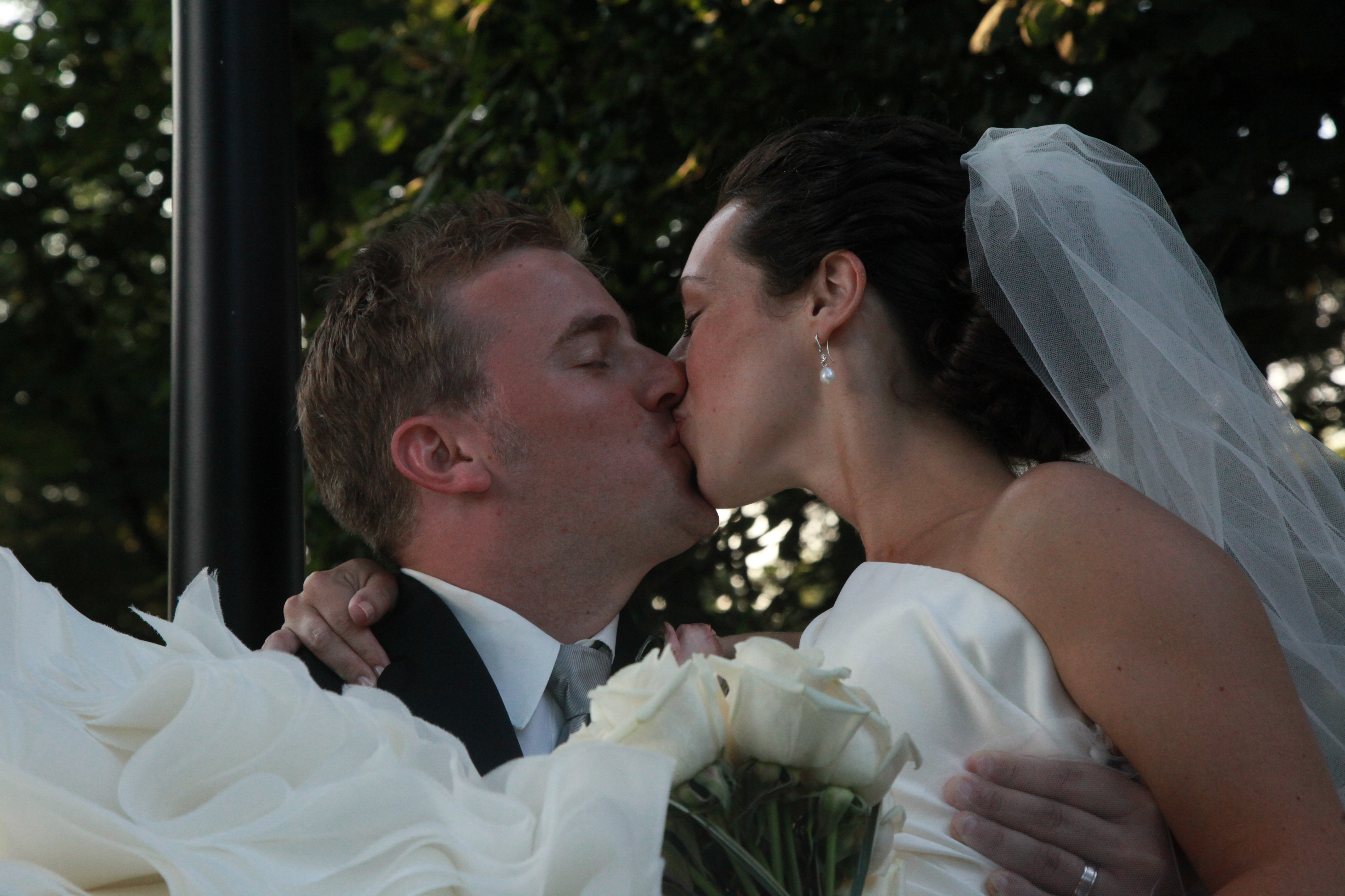 Groom picks up bride with a Kiss