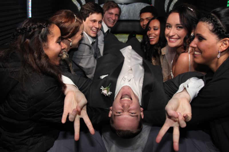 Groom lying on the bridal party