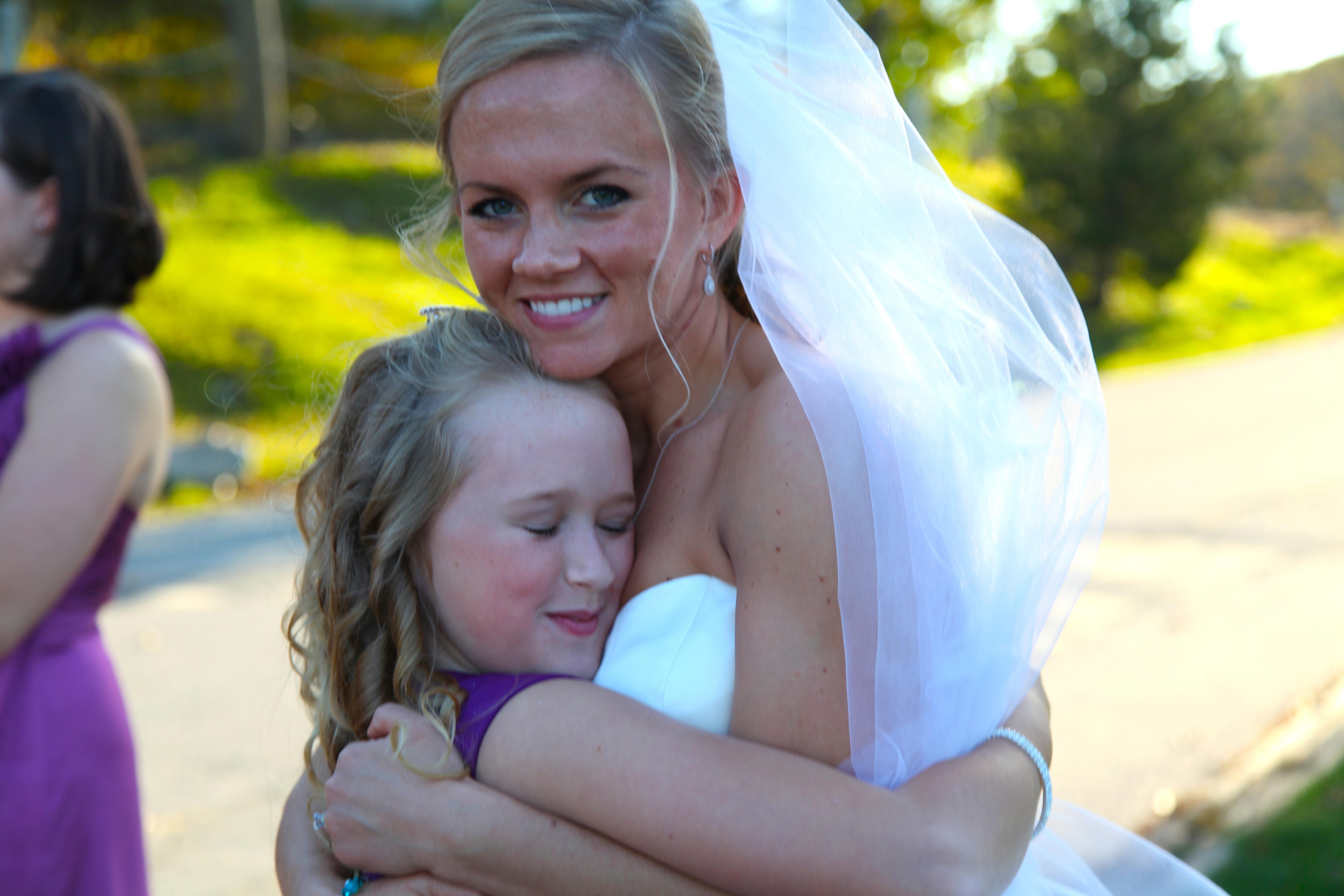 Bride holds the flower girl