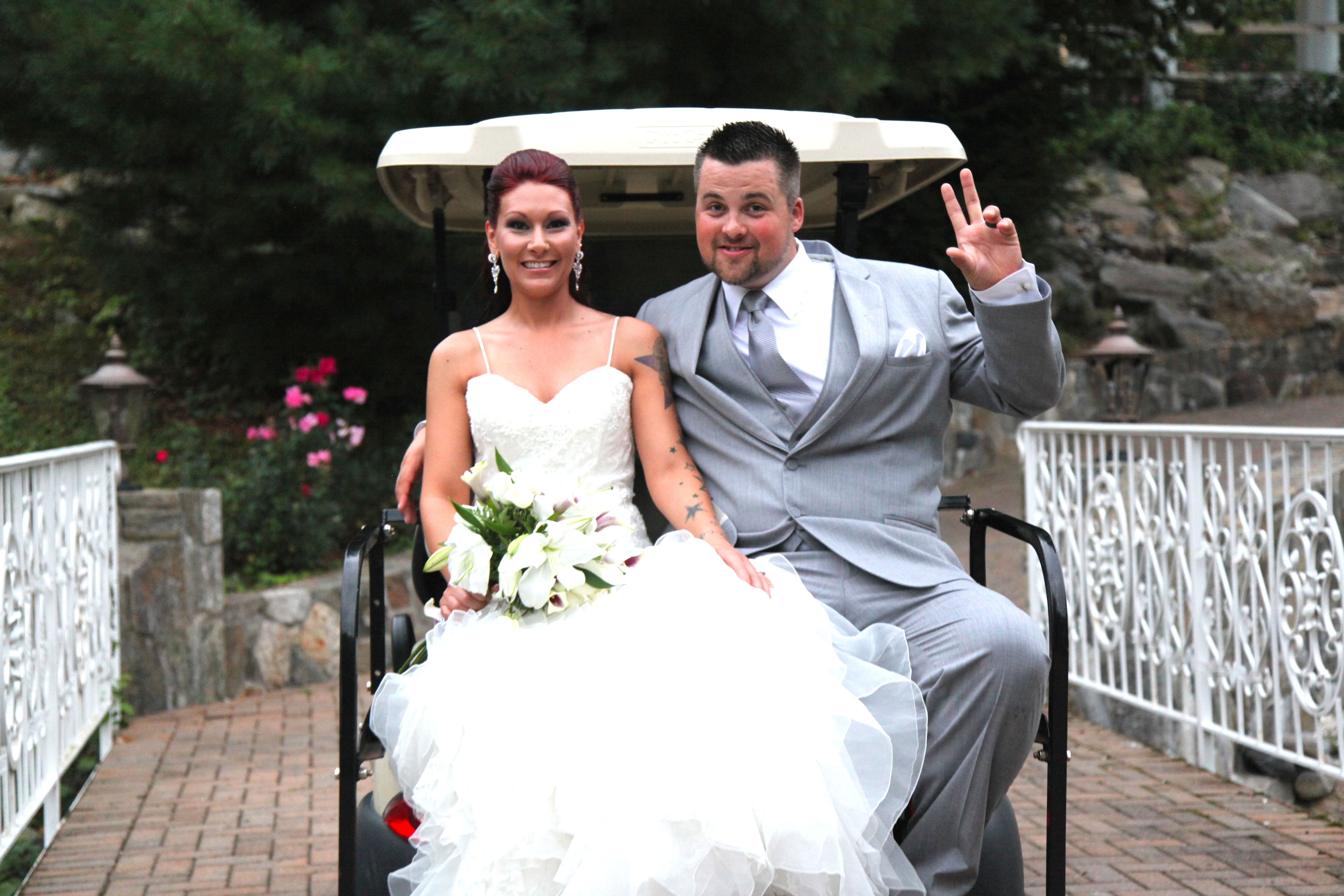 Bride and Groom in a Golf Cart