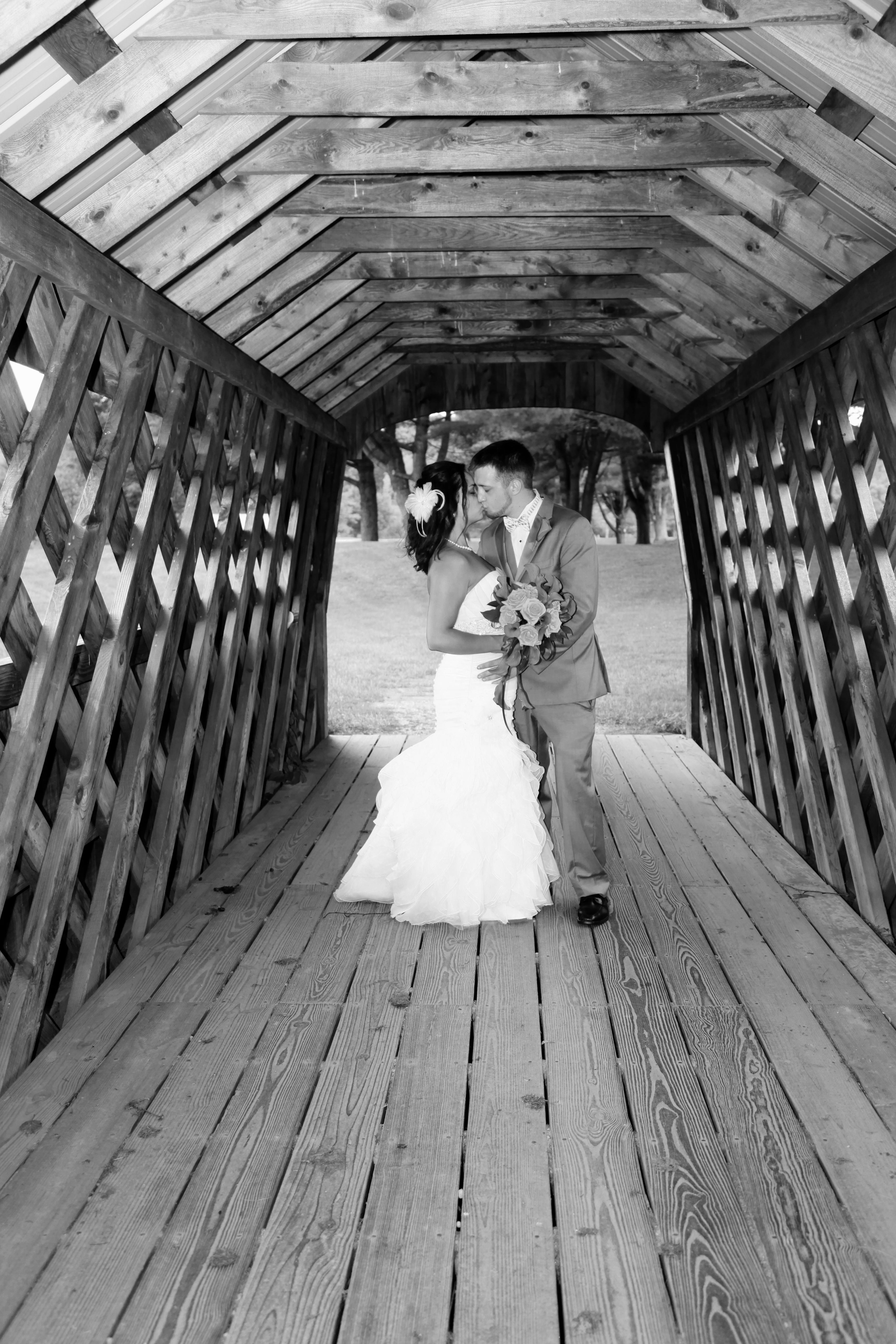 Kiss on a covered bridge